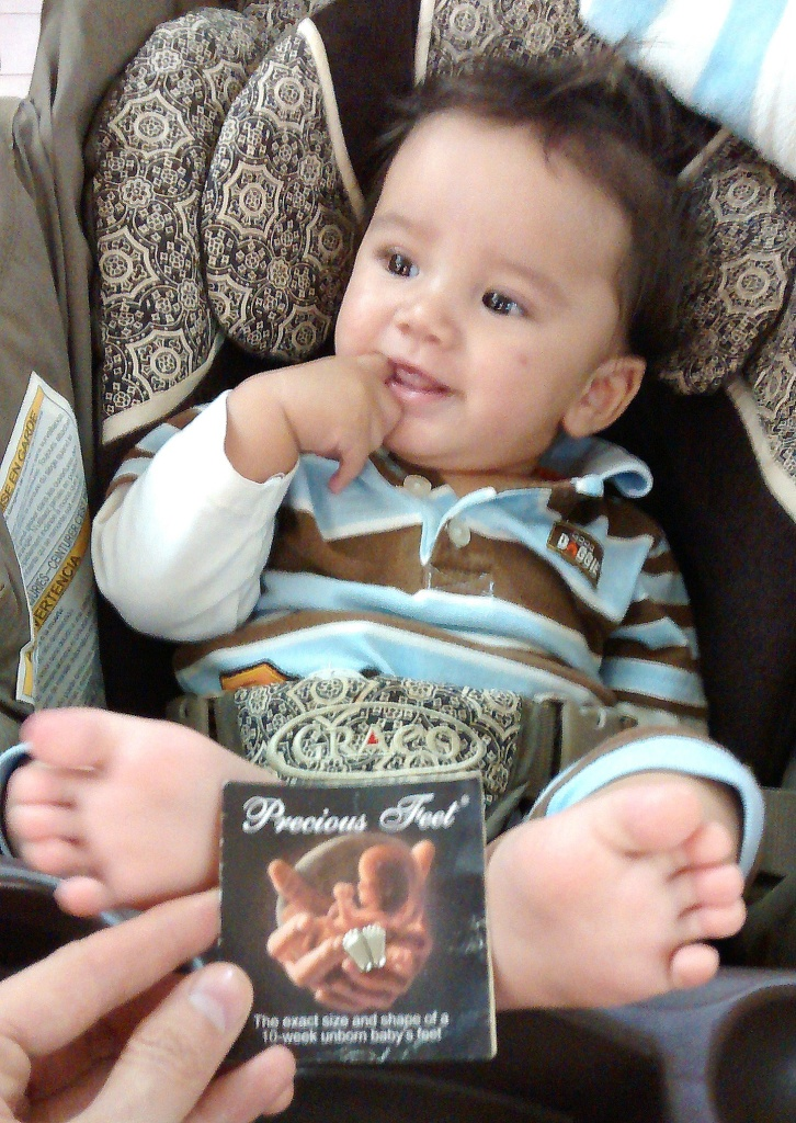 Five month old Noah's feet are much bigger now than they were at 10 weeks (like the pin) when he was almost aborted!